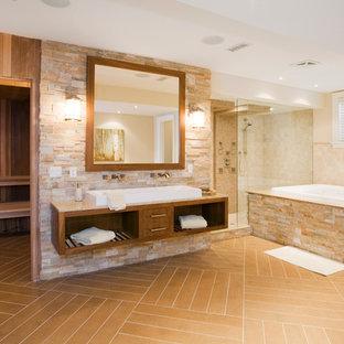 Imagen de sauna de estilo americano, grande, con armarios abiertos, puertas de armario de madera oscura, bañera encastrada, ducha empotrada, baldosas y/o azulejos beige, baldosas y/o azulejos marrones, baldosas y/o azulejos de piedra, suelo de baldosas de porcelana, lavabo sobreencimera, encimera de granito, suelo marrón y ducha con puerta con bisagras