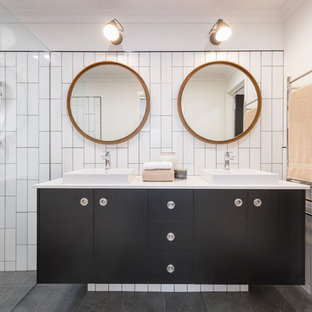 Inspiration for a contemporary 3/4 bathroom in Perth with black cabinets, white tile, ceramic tile, white walls, ceramic floors, grey floor, an open shower, flat-panel cabinets, a curbless shower and a vessel sink.