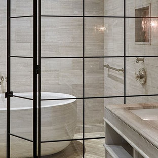 Inspiration for a large asian master wet room bathroom in New York with open cabinets, light wood cabinets, a freestanding tub, beige tile, ceramic tile, beige walls, travertine floors, an undermount sink, engineered quartz benchtops, beige floor and an open shower.