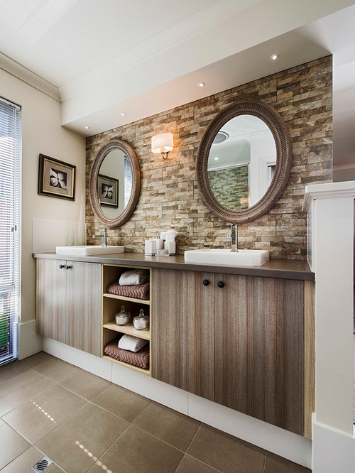 Inspiration for a mid-sized contemporary master brown tile bathroom remodel  in Perth with an