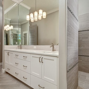 Example of a large arts and crafts 3/4 gray tile and porcelain tile porcelain tile doorless shower design in Boise with shaker cabinets, white cabinets, gray walls, an undermount sink and quartz countertops
