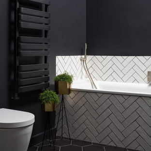 This is an example of a contemporary bathroom in London with a built-in bath.