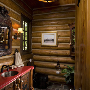 Mountain style slate floor bathroom photo in Other with furniture-like cabinets and dark wood cabinets
