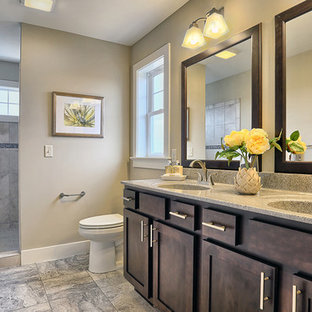 Bathroom - large craftsman master beige tile ceramic tile and multicolored floor bathroom idea in Other with raised-panel cabinets, dark wood cabinets, granite countertops, a two-piece toilet, beige walls and an integrated sink