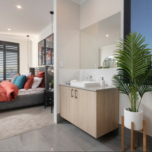 Mid-sized contemporary 3/4 bathroom in Perth with flat-panel cabinets, beige cabinets, beige walls, porcelain floors, a vessel sink, grey floor and grey benchtops.