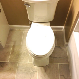 Bathroom - small transitional master white tile and porcelain tile porcelain floor bathroom idea in Other with an integrated sink, flat-panel cabinets, white cabinets, solid surface countertops, a one-piece toilet and beige walls