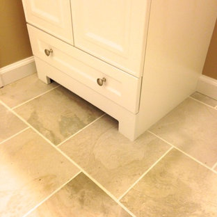 Inspiration for a small transitional master white tile and porcelain tile porcelain tile bathroom remodel in Other with an integrated sink, flat-panel cabinets, white cabinets, solid surface countertops, a one-piece toilet and beige walls