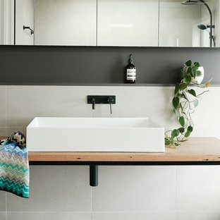 Design ideas for a contemporary bathroom in Canberra - Queanbeyan with white tile, white walls, a vessel sink, wood benchtops, white floor and brown benchtops.