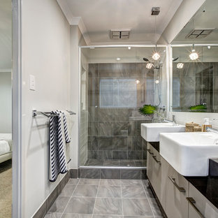 Contemporary 3/4 bathroom in Perth with flat-panel cabinets, grey cabinets, an alcove shower, gray tile and grey walls.