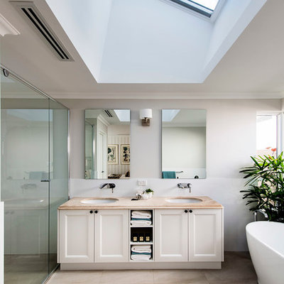 Freestanding bathtub - large traditional master freestanding bathtub idea in Perth with an undermount sink, recessed-panel cabinets, white cabinets and white walls