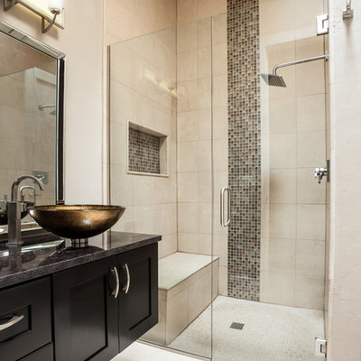 Example of a trendy beige tile bathroom design in Austin with a vessel sink, shaker cabinets, black cabinets, beige walls and a niche