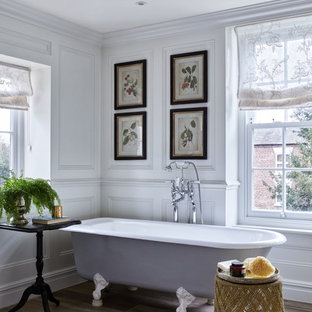 Inspiration for a traditional bathroom in Brisbane with a claw-foot tub, white walls and brown floor.