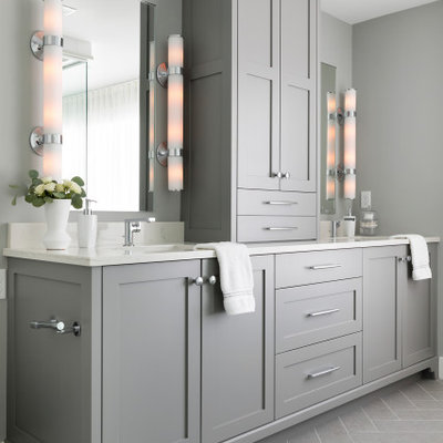 Bathroom - large transitional master porcelain tile, gray floor and double-sink bathroom idea in Minneapolis with shaker cabinets, gray cabinets, a one-piece toilet, gray walls, an undermount sink, solid surface countertops, a hinged shower door, white countertops and a built-in vanity