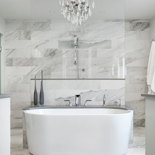 Inspiration for a transitional master gray tile, white tile and marble tile marble floor bathroom remodel in Toronto with flat-panel cabinets and white cabinets