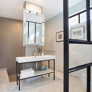 Contemporary master bathroom in Gold Coast - Tweed with furniture-like cabinets, black cabinets, a japanese tub, an open shower, a wall-mount toilet, gray tile, porcelain tile, grey walls, marble floors, white floor, an open shower and a console sink.