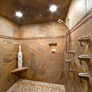 Bathroom - small farmhouse master beige tile and stone tile travertine floor bathroom idea in Other with a vessel sink, shaker cabinets, medium tone wood cabinets, granite countertops, a one-piece toilet and gray walls