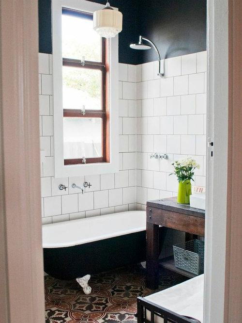 Bagno vittoriano con pavimento in cemento foto idee arredamento - Vasca da bagno con piedi ...