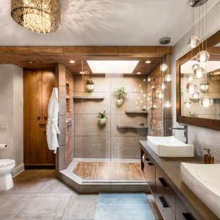 Inspiration for a large tropical master gray tile and ceramic tile gray floor and ceramic tile bathroom remodel in Minneapolis with flat-panel cabinets, dark wood cabinets, a one-piece toilet, white walls, a vessel sink and concrete countertops