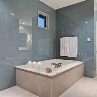 Example of a large classic master blue tile and glass tile porcelain floor bathroom design in Dallas with blue walls