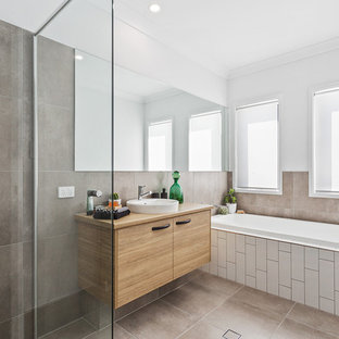 Design ideas for a contemporary bathroom in Brisbane with flat-panel cabinets, light wood cabinets, a drop-in tub, a curbless shower, white walls, a vessel sink, wood benchtops, brown floor and an open shower.
