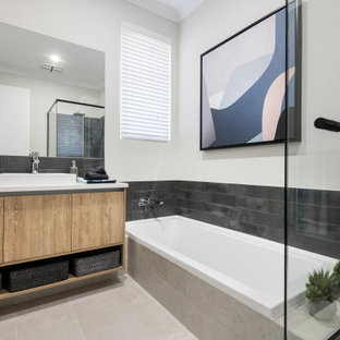 Mid-sized contemporary 3/4 bathroom in Perth with flat-panel cabinets, beige cabinets, a drop-in tub, a shower/bathtub combo, gray tile, white walls, porcelain floors, a vessel sink, beige floor, an open shower, white benchtops, a single vanity and a floating vanity.