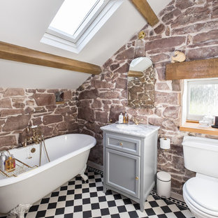 Inspiration for a small country bathroom in Other with furniture-like cabinets, grey cabinets, a claw-foot tub, a shower/bathtub combo, a two-piece toilet, black and white tile, porcelain tile, grey walls, porcelain floors, an undermount sink and marble benchtops.