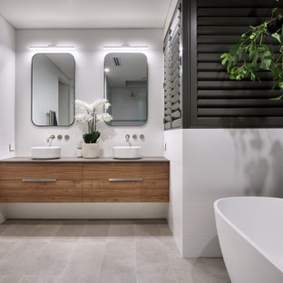Contemporary master bathroom in Perth with brown cabinets, multi-coloured tile, a vessel sink, solid surface benchtops, an open shower, a single vanity, a built-in vanity, flat-panel cabinets, a freestanding tub, an alcove shower and grey floor.