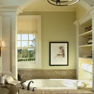 Ejemplo de cuarto de baño clásico con lavabo bajoencimera, puertas de armario blancas, bañera encastrada, baldosas y/o azulejos beige y baldosas y/o azulejos en mosaico