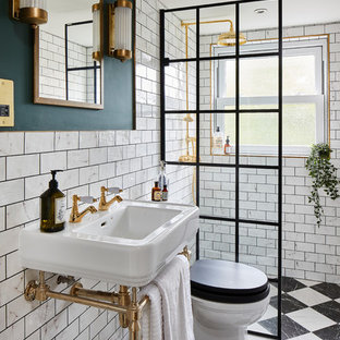 Photo of a victorian shower room bathroom in London with white tiles, metro tiles, green walls, a console sink, multi-coloured floors and an open shower.