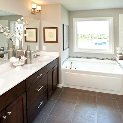 Example of a classic brown tile bathroom design in Minneapolis with an integrated sink, shaker cabinets and dark wood cabinets