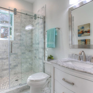 Bathroom - small contemporary 3/4 white tile, gray tile and marble tile ceramic tile and gray floor bathroom idea in Tampa with white cabinets, a two-piece toilet, white walls, an undermount sink, marble countertops and flat-panel cabinets