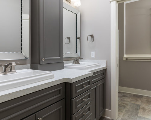 Bathroom with grey cabinets and laminate floors ideas for Bathroom cabinets grand rapids mi