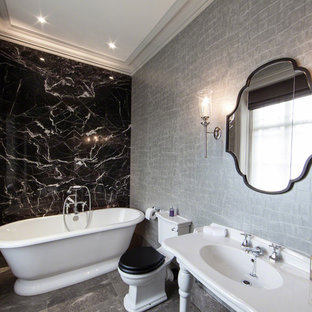Freestanding bathtub - contemporary marble tile freestanding bathtub idea in Manchester