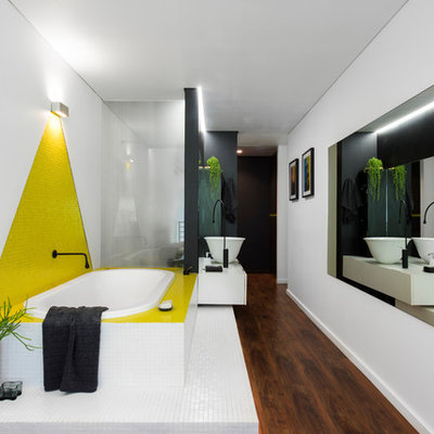 Small trendy master yellow tile and mosaic tile linoleum floor and brown floor drop-in bathtub photo in Sydney with white walls, a vessel sink, solid surface countertops, flat-panel cabinets and white cabinets