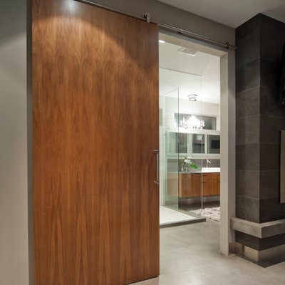 Corner shower - contemporary corner shower idea in Vancouver with a vessel sink, flat-panel cabinets and medium tone wood cabinets