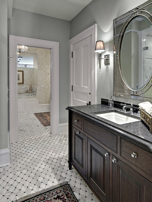 Bathroom   Traditional Bathroom Idea In Minneapolis With Raised Panel  Cabinets, Dark Wood Cabinets