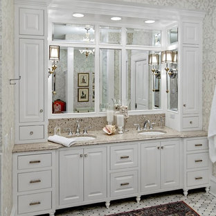 Design ideas for a traditional bathroom in Minneapolis with an undermount sink, raised-panel cabinets, white cabinets, granite benchtops and beige benchtops.