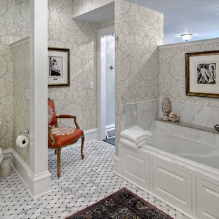 Example of a mid-sized classic master mosaic tile marble floor alcove bathtub design in Minneapolis with multicolored walls and a two-piece toilet