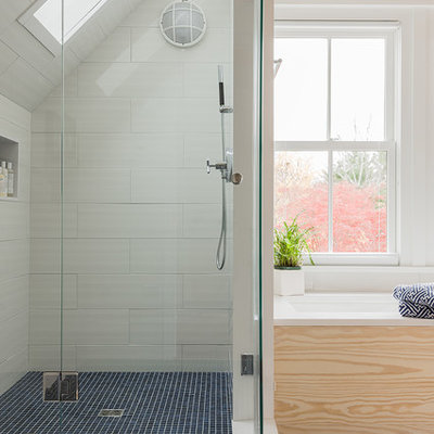 Corner shower - mid-sized coastal white tile and ceramic tile mosaic tile floor and blue floor corner shower idea in Boston with white walls, an undermount tub, an undermount sink and quartz countertops