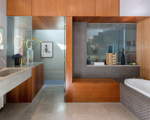 large contemporary and modern bathroom in london with flat panel cabinets medium wood cabinets - Bathroom Ideas Contemporary