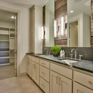Example of a mid-sized mountain style master white tile and ceramic tile ceramic tile doorless shower design in Omaha with flat-panel cabinets, gray cabinets, a one-piece toilet, white walls, an undermount sink and soapstone countertops