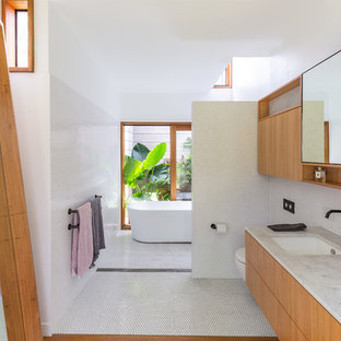 Modern master bathroom in Gold Coast - Tweed with flat-panel cabinets, medium wood cabinets, a freestanding tub, an open shower, white tile, mosaic tile, white walls, medium hardwood floors, an undermount sink, brown floor, an open shower and grey benchtops.