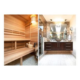 Imagen de cuarto de baño principal, actual, de tamaño medio, con lavabo sobreencimera, armarios con paneles lisos, puertas de armario de madera en tonos medios, encimera de cuarzo compacto, ducha esquinera, baldosas y/o azulejos beige, baldosas y/o azulejos de porcelana, sanitario de dos piezas, paredes grises y suelo de baldosas de porcelana