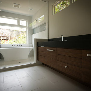 Large trendy master beige floor bathroom photo in San Francisco with flat-panel cabinets, dark wood cabinets, beige walls, an undermount sink and a hinged shower door
