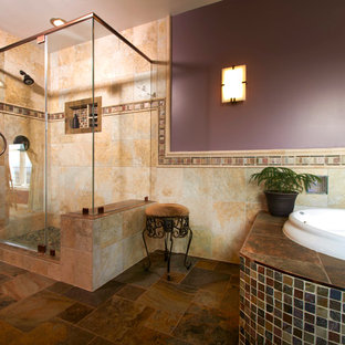 Inspiration for a large mediterranean master brown tile and porcelain tile slate floor bathroom remodel in Other with an undermount sink, raised-panel cabinets, granite countertops, a two-piece toilet and purple walls