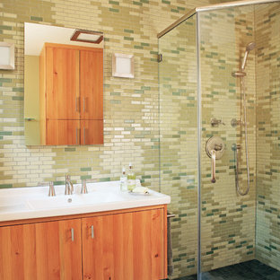 Inspiration for a mid-sized 1950s 3/4 brown tile, green tile and matchstick tile slate floor corner shower remodel in San Francisco with flat-panel cabinets, medium tone wood cabinets, a two-piece toilet, green walls and a drop-in sink
