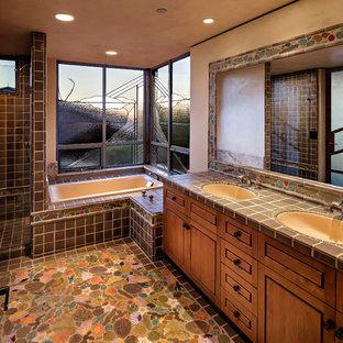 Southwest Master Multicolored Floor Bathroom Photo In Phoenix With Medium Tone Wood Cabinets Beige Walls