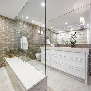 Freestanding bathtub - large transitional master gray tile and ceramic tile limestone floor and beige floor freestanding bathtub idea in Ottawa with white cabinets, gray walls, shaker cabinets and engineered quartz countertops