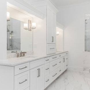 Huge trendy master white tile and marble tile porcelain tile and white floor freestanding bathtub photo in Atlanta with recessed-panel cabinets, white cabinets, a two-piece toilet, white walls, an undermount sink and quartz countertops