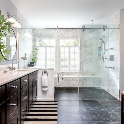 Bathroom - large contemporary master marble floor and black floor bathroom idea in Seattle with recessed-panel cabinets, dark wood cabinets, quartz countertops, white countertops, gray walls and an undermount sink